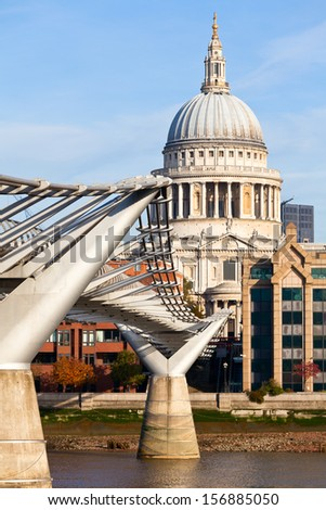 St Paul's Cathedral with Millennium Bridge in the foreground - stock photo