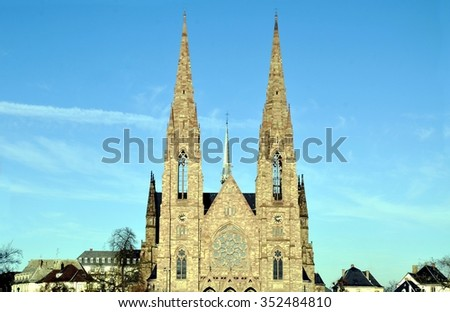 St  Paul's Church in Strasbourg with blue sky - Alsace, France. View on the St. Paul Church from the Ill river. - stock photo