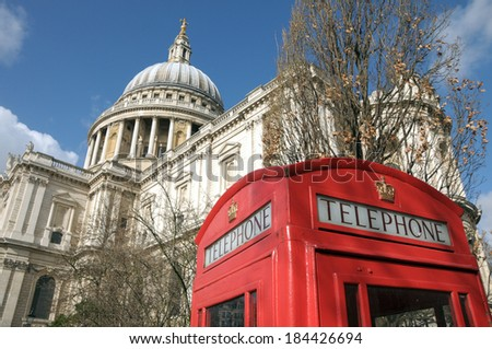 St Pauls Cathedral in London with telephone kiosk - stock photo