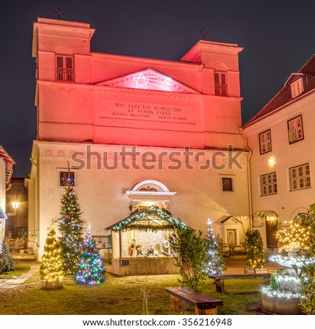 St. Peter and St. Paul's Cathedral, a Roman Catholic cathedral in Christmas decorations including a nativity scene. Tallinn, Estonia. - stock photo