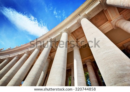 St. Peter's Basilica colonnades, columns in Vatican City. Blue sky