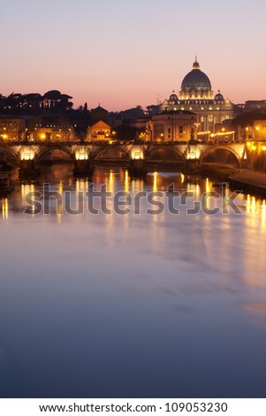 St. Peter's Basilica in Rome - Tiber River on foreground - stock photo