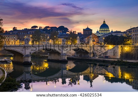 St. Peter's cathedral (Basilica di San Pietro) and bridge (Ponte Vittorio Emanuele II) over river Tiber in the evening after sunrise, Rome, Italy, Europe - stock photo
