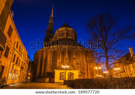 St.Peter's Church in Old Town Riga (Latvia) at night - stock photo