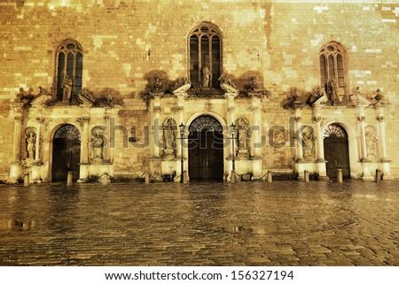 St. Peters churchs entrance entrance by night in the rain. Riga, Latvia - stock photo