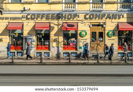 ST. PETERSBURG - CIRCA MARCH 2013: Coffee shop in Nevsky Prospect Ave. in St. Petersburg, circa March 2013. A tourist attraction with 221 museums, 2000 libraries, and 80 plus theaters within the city. - stock photo