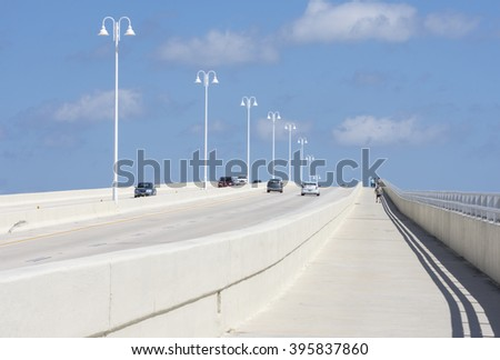 ST. PETERSBURG, FLORIDA, USA - FEBRUARY 25, 2016: Two-way traffic and a pedestrian walkway on the highway 682 concrete bridge connect St. Pete Beach and Isla del Sol on Florida's gulf coast. - stock photo