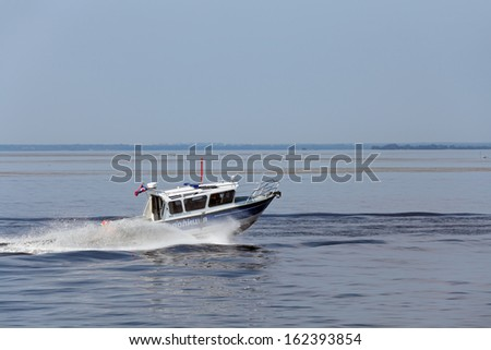 ST.-PETERSBURG - JUL 05: Sea testing on the water of police boat on International maritime defence show (IMDS-2013) on Jul 05, 2013 at Lenexpo exhibition complex in St.-Petersburg, Russia