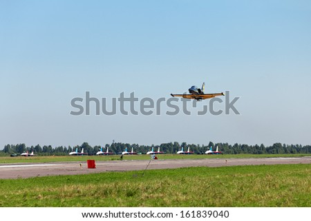 ST.-PETERSBURG - JUL 04: The plane aerobatic group Russ the participants of the airshow on International maritime defence show (IMDS-2013) on Jul 04, 2013 at airfield Pushkin in St.-Petersburg, Russia