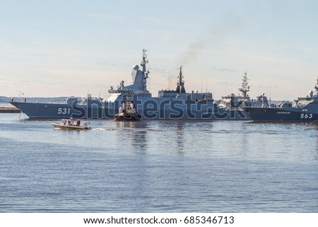 St. Petersburg. Kronshtadt-27.07.2017: The minesweepers take the warship to the fairway