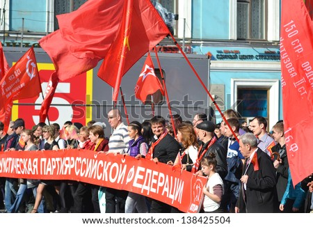 ST.PETERSBURG - MAY 9: Communist demonstration on the Nevsky Prospect. People walking to celebrate World War II Victory Day on May 9, 2013 in St.Petersburg, Russia.