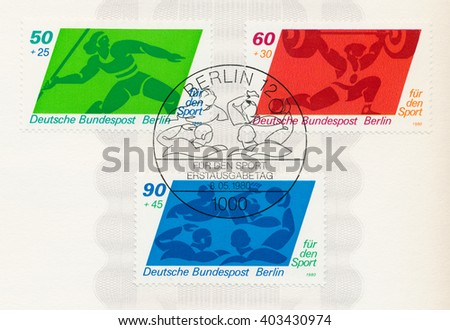 ST. PETERSBURG, RUSSIA - APR 8, 2016: A first day of issue postmark printed in Berlin, Germany, shows javelin, weight lifter, water polo, circa 1980 - stock photo