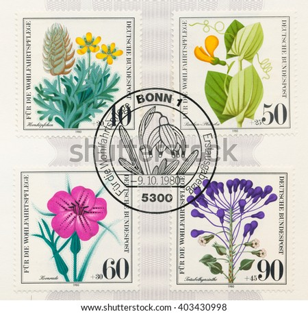 ST. PETERSBURG, RUSSIA - APR 8, 2016: A first day of issue postmark printed in Berlin, Germany, shows Wildflowers: Ceratocephalus, Climbing meadow pea. Corn cockle. Grape hyacinth, circa 1980 - stock photo