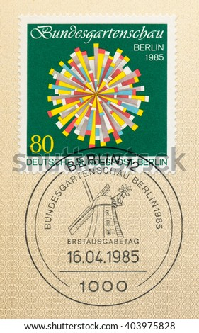 ST. PETERSBURG, RUSSIA - APR 10, 2016: A first day of issue postmark printed in Berlin, Germany, shows Symbolic flower. 1985 Berlin Horticultural Show. Windmill on the stamp, circa 1985 - stock photo