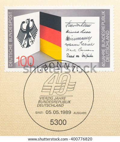 ST. PETERSBURG, RUSSIA - APR 4, 2016: A first day of issue postmark printed in Bonn, Germany, shows coat of arms, flag, sign, Federal Republic of Germany, 40th Anniv., circa 1989 - stock photo