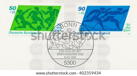 ST. PETERSBURG, RUSSIA - APR 7, 2016: A first day of issue postmark printed in Bonn, Germany, shows Soccer and Cross-country skiing, circa 1980 - stock photo