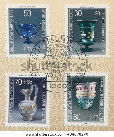 ST. PETERSBURG, RUSSIA - APR 11, 2016: A first day of issue postmark printed in  Germany, shows Cantharus, 1st cent. Tumbler, c. 200. Jug, 3rd cent. Diatreta, 4th cent. Series Glassware, circa 1986 - stock photo