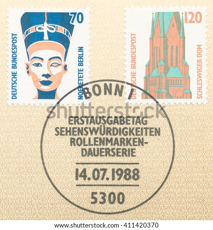 ST. PETERSBURG, RUSSIA - APR 25, 2016: A first day of issue postmark printed in Germany, shows Queen Nefertiti of Egypt, bust, Egyptian Museum, Berlin and Schleswig Cathedral, circa 1988 - stock photo