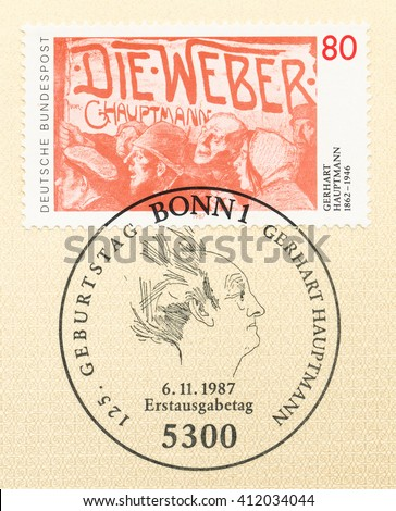 ST. PETERSBURG, RUSSIA - APR 27, 2016: A first day of issue postmark printed in Germany, shows weavers. Gerhart Hauptmann (1862-1946), Playwright, circa 1987 - stock photo