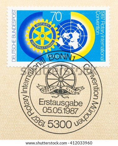 ST. PETERSBURG, RUSSIA - APR 27, 2016: A first day of issue postmark printed in Germany, shows gear, globe, wheel. Rotary International Convention, Munich, June 7-10, circa 1987 - stock photo