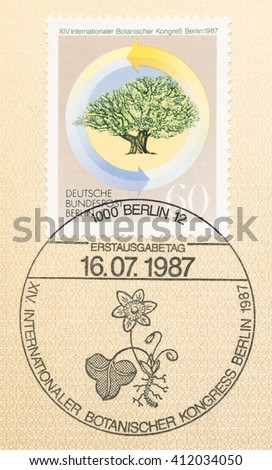 ST. PETERSBURG, RUSSIA - APR 27, 2016: A first day of issue postmark printed in Germany, shows tree and flower arrows on the stamp. 14th International Botanical Congress, circa 1987 - stock photo