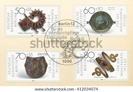 ST. PETERSBURG, RUSSIA - APR 27, 2016: A postmark Germany, shows Artifacts: Bonnet ornament, 5th cent. Athena plate, 1st cent. B.C. Armilla armlet, c. 1180. Snake bracelet, 300 B.C., circa 1987 - stock photo