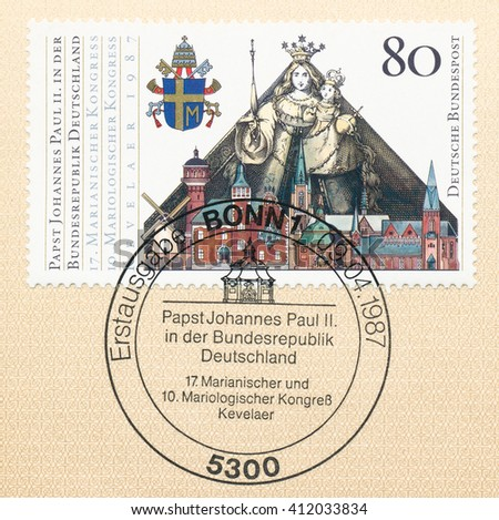 ST. PETERSBURG, RUSSIA - APR 27, 2016: A postmark Germany, shows Papal Arms, Madonna and Child, Buildings in Kevelaer. State visit of Pope John Paul II,  Congress, Kevelaer, Sept. 11-20, circa 1987 - stock photo