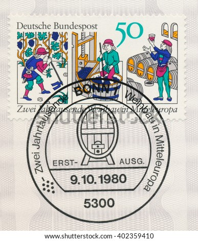 ST. PETERSBURG, RUSSIA - APR 7, 2016: A postmark printed in Bonn, Germany, shows Hoeing, Pressing Grapes, Wine Cellar 14th Century Woodcuts. Wine production in Central Europe 2000th anniv., circa 1980 - stock photo