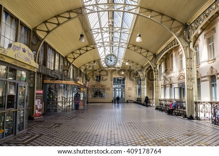 St. Petersburg, Russia-April 16, 2016. Architectural details: atrium, vaulted ceiling, metal supports, tiled floor - the interior of the Vitebsk railway station. Russian wolds are: welcome, souvenirs.