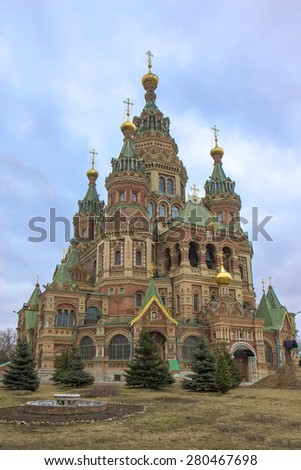 ST PETERSBURG, RUSSIA - APRIL 01, 2015: Church of St. Peter and Paul was built in 1905 in the neo-Russian style and is constructed of brick. It is one of the few cathedrals that survived the war. - stock photo