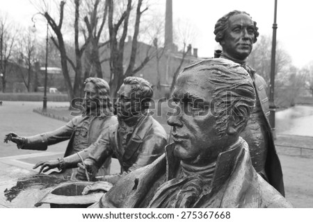 "ST.PETERSBURG, RUSSIA - APRIL 26, 2015: Sculptural composition ""The great architects"" in St-Petersburg, Russia. Black and white. - stock photo"