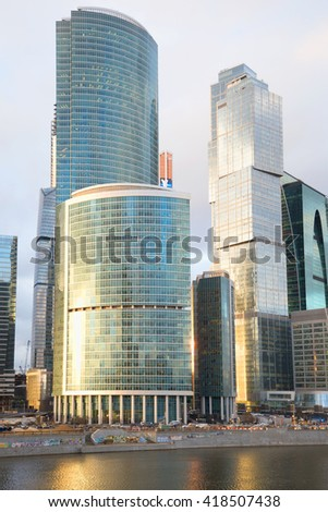 "ST. PETERSBURG, RUSSIA - APRIL 14, 2015: Shells of the complex ""Moscow City"" close up at sunset"