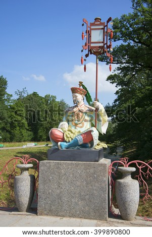 ST. PETERSBURG, RUSSIA - AUGUST 03, 2014: A Chinaman with a lantern. The sculpture on the Big Chinese bridge in Tsarskoye Selo