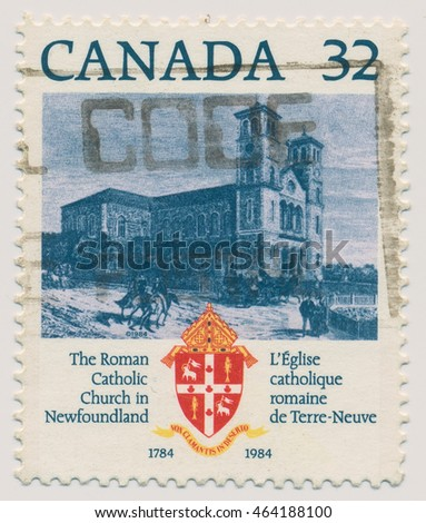 ST. PETERSBURG, RUSSIA - AUGUST 2, 2016: A postmark printed in CANADA, shows St. Johns Basilica, Roman Catholic Church in Newfoundland 1784 and coat of arms of the Archbishopric, circa 1984