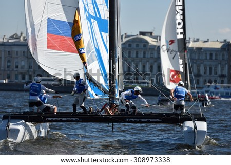 ST. PETERSBURG, RUSSIA - AUGUST 21, 2015: Catamaran of Gazprom Team Russia during 2nd day of St. Petersburg stage of Extreme Sailing Series. Red Bull Sailing Team of Austria leading after the 1st day - stock photo