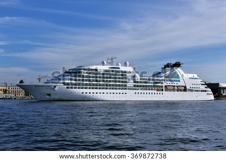 ST. PETERSBURG, RUSSIA - AUGUST 5, 2015: Cruise liner Seabourn Quest departs from the Neva river. The ship built in 2011 provides luxury cruise for 450 guests