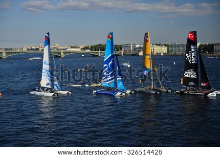 ST. PETERSBURG, RUSSIA - AUGUST 22, 2015: Extreme 40 catamarans during the 3rd day of St. Petersburg stage of Extreme Sailing Series. The Wave, Muscat team of Oman leading after 2 days - stock photo