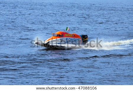 ST.PETERSBURG, RUSSIA - AUGUST 09: speed boat on water on line on Neva at Formula 1 Powerboat World Championship race on August 09, 2009 in St.Petersburg, Russia. - stock photo