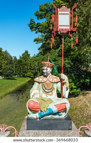 ST PETERSBURG, RUSSIA - AUGUST 24, 2015: Statue of a chinese man on the Grand Chinese Bridge, Alexander Park in Tsarskoe Selo