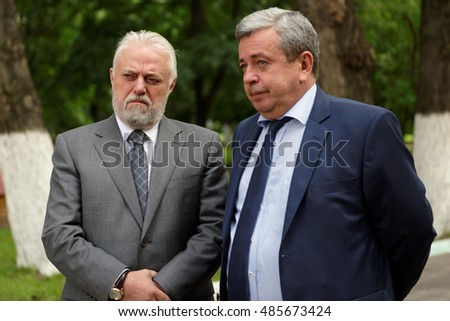 ST. PETERSBURG, RUSSIA - AUGUST 25, 2016: Vice-governor of St. Petersburg Igor Divinsky and general director of Oktyabrsky electric railway car repair plant Boris Bogatyrev