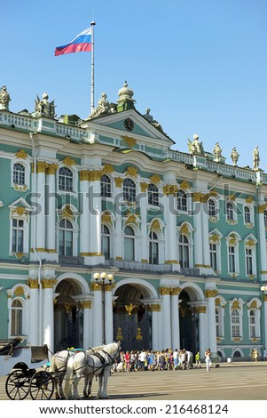 ST. PETERSBURG, RUSSIA-August 06: Winter Palace and Hermitage museum in Saint Petersburg, Russia, a major tourist attraction on August 06, 2014. - stock photo