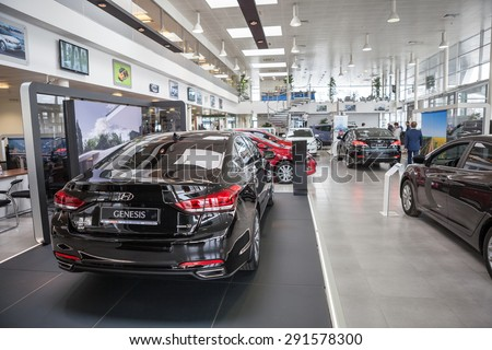 ST. PETERSBURG, RUSSIA - CIRCA APR, 2015: Hyundai Genesis luxury car is in auto dealership showroom. The Rolf Lahta is a official dealer of Hyundai - stock photo