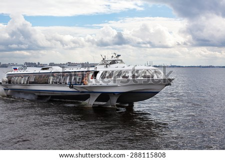 "ST. PETERSBURG, RUSSIA - CIRCA JUL, 2011: Pleasure speedboat hydrofoil ""Meteor"" floats in the Gulf of Finland. Russian commercial water transport"