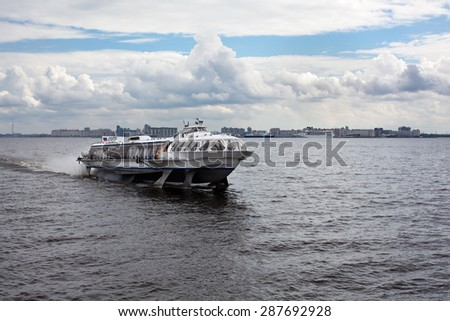 "ST. PETERSBURG, RUSSIA - CIRCA JUL, 2011: Pleasure speedboat with underwater wings ""Meteor"" floats in the Gulf of Finland. Russian commercial water transport"