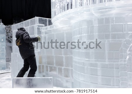 ST. PETERSBURG, RUSSIA - DECEMBER 19, 2017: Creating the ice fortress for the opening of the festival Ice Fantasy - 2018. This year 180 tonnes of ice was used for creating ice compositions