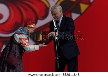 ST. PETERSBURG, RUSSIA - DECEMBER 16, 2015: Rector of Saint-Petersburg State University of Culture and Arts Alexander Turgayev (center) presenting awards during the closing ceremony of Cultural Forum - stock photo
