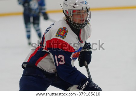 ST. PETERSBURG, RUSSIA - FEBRUARY 17, 2016: Kristina Nizovtseva of  women's ice hockey team Biryusa Krasnoyarsk in the match against Dinamo Saint-Petersburg. Dinamo won the match 3-1 - stock photo