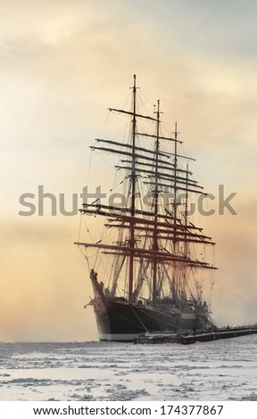 ST.PETERSBURG,RUSSIA-JANUARY 23:Barque Sedov was launched in Kiel in 1921,icebound anchored in St. Petersburg,Russia on January 23,2014.She participates regularly in big maritime international events