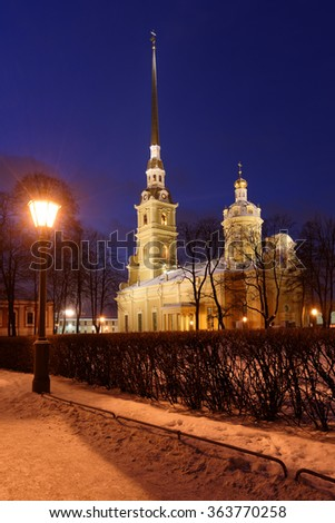 ST. PETERSBURG, RUSSIA - JANUARY 4, 2016: Night view to St. Peter and Paul Cathedral in winter. Built between 1712 and 1733, it is the first and oldest landmark in St. Petersburg - stock photo