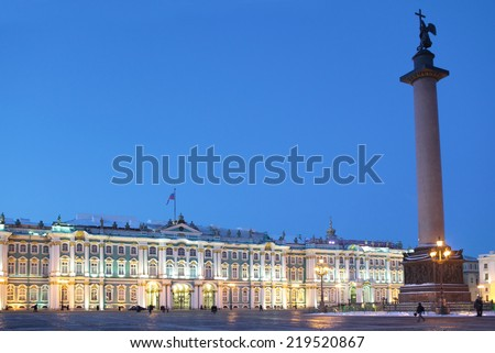 ST. PETERSBURG, RUSSIA - JANUARY 17, 2013: People walk near the Alexander Column against the Winter Palace. The column was erected in 1834 after the Russian victory in the war with Napoleon's France